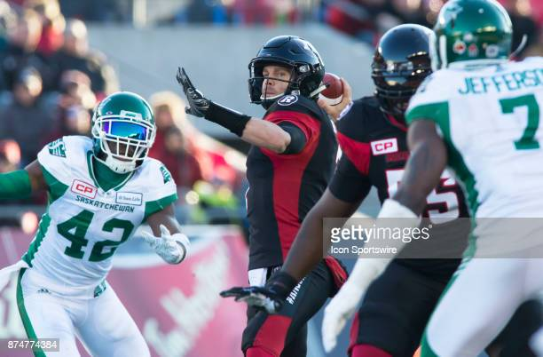 Trevor Harris of the Ottawa Redblacks holds steady in the pocket and delivers a pass against the Saskatchewan Roughriders in Canadian Football League...