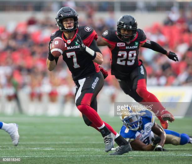Trevor Harris of the Ottawa Redblacks looks downfield for a receiver against the Winnipeg Blue Bombers in Canadian Football League action at TD Place...