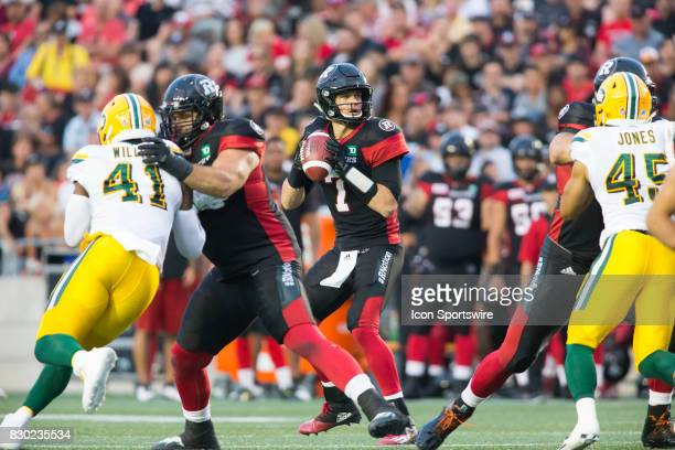Trevor Harris of the Ottawa Redblacks looks downfield for a receiver against the Edmonton Eskimos in Canadian Football League action at TD Place in...