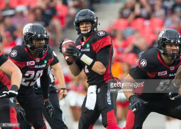 Trevor Harris of the Ottawa Redblacks looks for a receiver against the Winnipeg Blue Bombers in Canadian Football League action at TD Place Stadium...