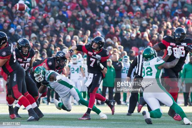 Trevor Harris of the Ottawa Redblacks looks for a receiver against the Saskatchewan Roughriders in Canadian Football League play during the CFL East...