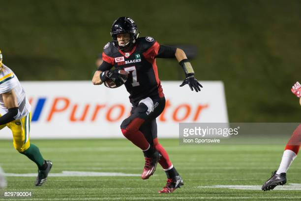 Trevor Harris of the Ottawa Redblacks runs the ball out of the pocket against the Edmonton Eskimos in Canadian Football League action at TD Place in...