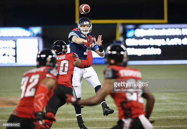 Trevor Harris of the Toronto Argonauts throws a touchdown pass during CFL game action against the Ottawa Redblacks on November 7 2014 at Rogers...