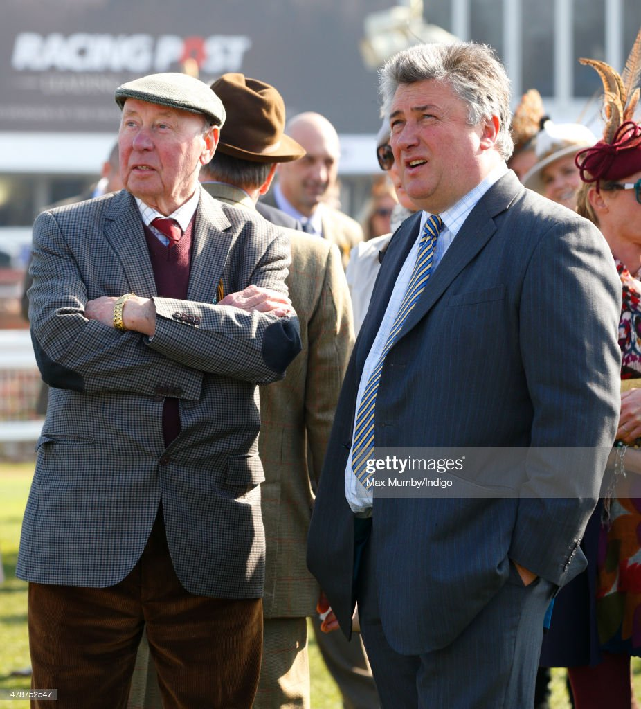 Trevor Hemmings and Paul Nicholls watch the racing as they attend Day 4 of the Cheltenham Festival at Cheltenham Racecourse on March 14, 2014 in Cheltenham, England.