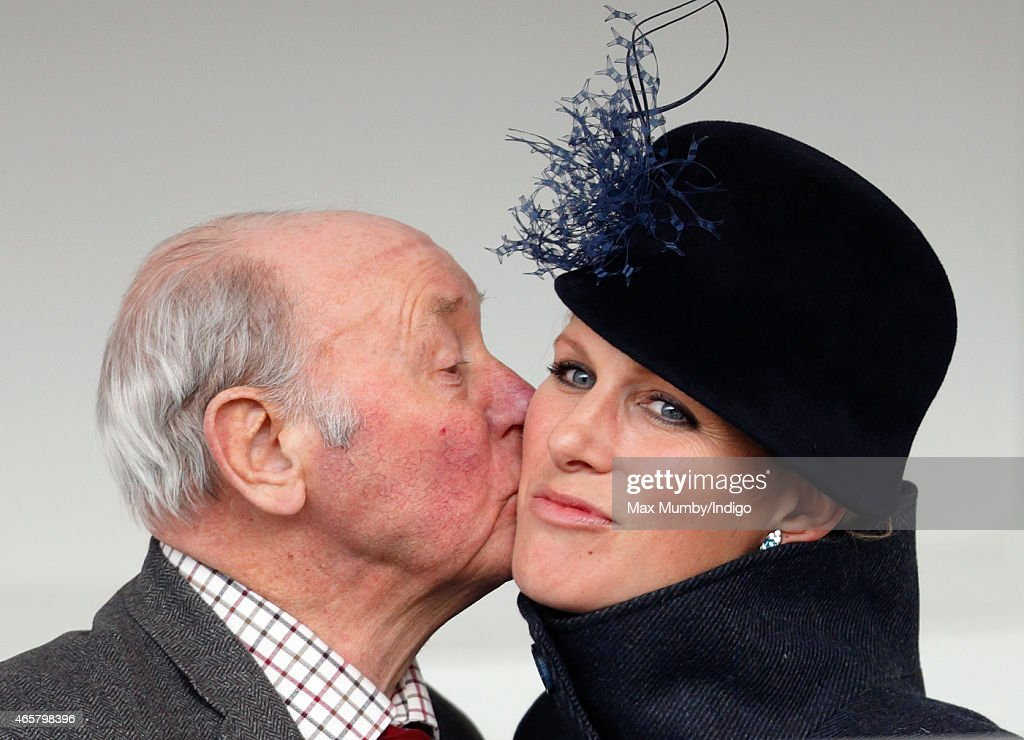 Trevor Hemmings kisses <a gi-track='captionPersonalityLinkClicked' href=/galleries/search?phrase=Zara+Phillips&family=editorial&specificpeople=161323 ng-click='$event.stopPropagation()'>Zara Phillips</a> as she attends day 1 of the Cheltenham Festival at Cheltenham Racecourse on March 10, 2015 in Cheltenham, England.