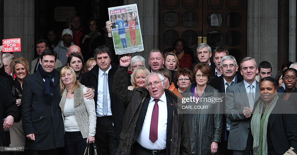 Trevor Hicks and other members of the Hillsborough Support Group and supporters pose on the steps of the High Court in central London on December 19, 2012, after the High Court quashed the original accidental death verdicts returned on 96 Liverpool football fans who died in the 1989 Hillsborough disaster. The request from the Attorney General to quash the original inquest verdicts follows the publication of a damning independent report in September which concluded that 41 of the 96 people who died would have had the 'potential to survive' if they had received medical treatment more quickly. Attorney General Dominic Grieve called for fresh inquests to be held.