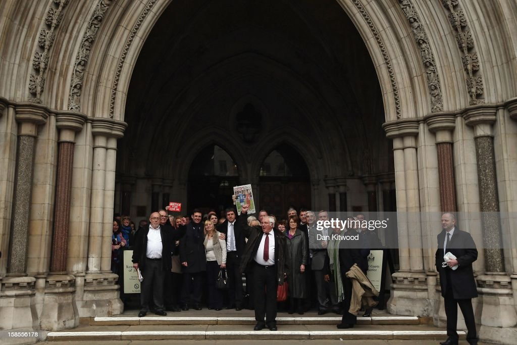 Trevor Hicks raises his fist as he stands with other families of the 96 football fans who lost their lives in the Hillsborough Disaster as they gather on the steps of the High Court on December 19, 2012 in London, England. An application presented by the attorney general, Dominic Grieve to Lord Chief Justice, Lord Judge has resulted in the quashing of the original accidental death verdict and an order for fresh inquests. The Hillsborough disaster occurred during the FA Cup semi-final tie between Liverpool and Nottingham Forest football clubs in April 1989 at the Hillsborough Stadium in Sheffield, which resulted in the deaths of 96 football fans.