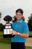 Trevor Immelman of South Africa holds up the trophy after winning the 2013 Hotel Fitness Championship at Sycamore Hills Golf Club on September 1 2013...