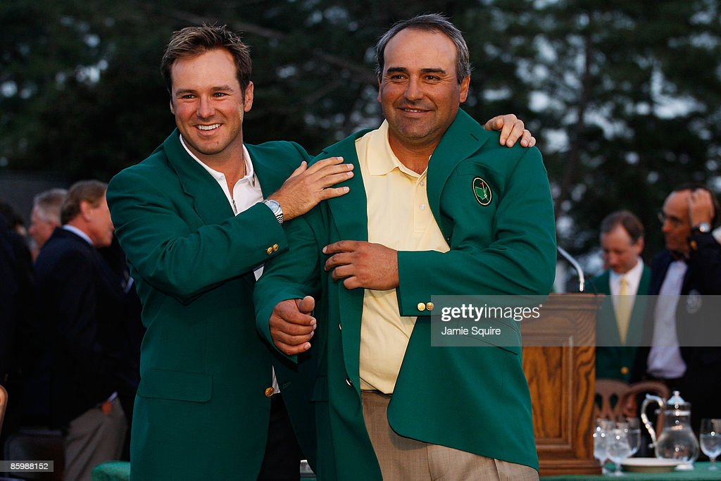 Trevor Immelman of South Africa presents Angel Cabrera of Argentina with the green jacket during the green jacket presentation after Cabrera defeated Kenny Perry on the second sudden death playoff hole to win the 2009 Masters Tournament at Augusta National Golf Club on April 12, 2009 in Augusta, Georgia.