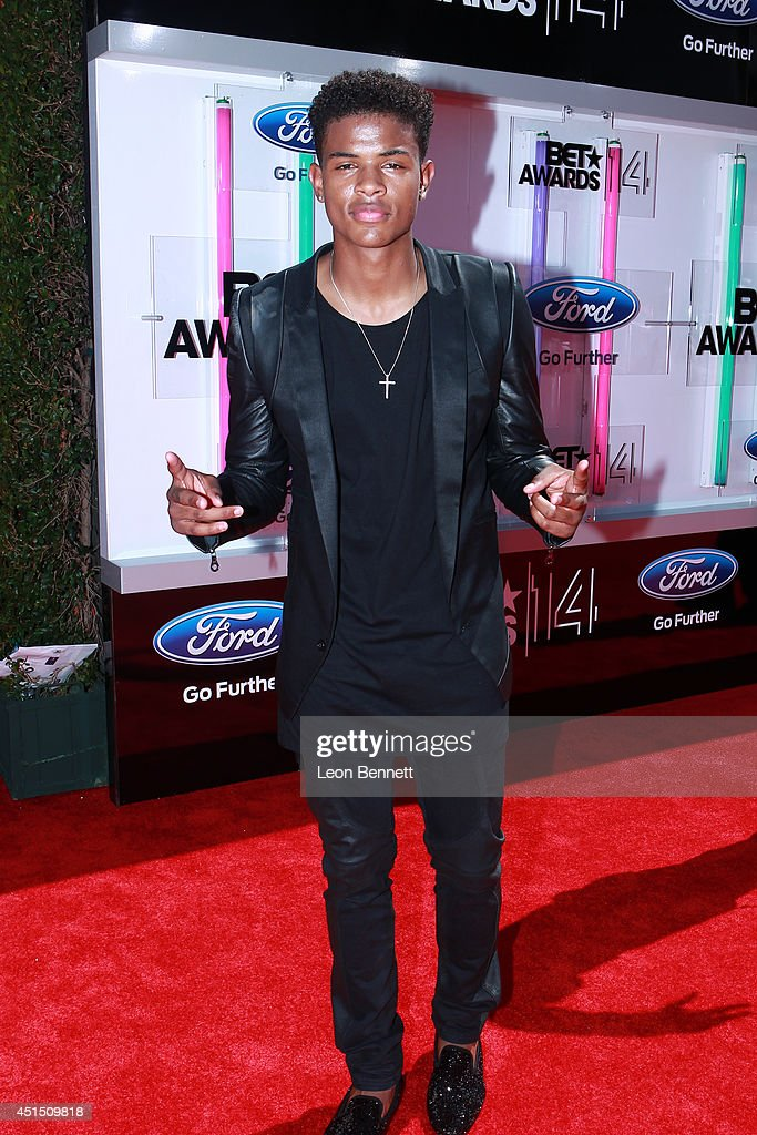 <a gi-track='captionPersonalityLinkClicked' href=/galleries/search?phrase=Trevor+Jackson+-+Performer&family=editorial&specificpeople=2269173 ng-click='$event.stopPropagation()'>Trevor Jackson</a> arrived at the BET & Make A Wish Foundation Recipient Wish To Attend BET Awards Red Carpet Arrivals on June 29, 2014 in Los Angeles, California.