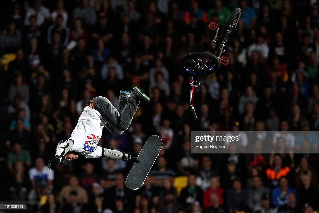 Trevor Jacob switches from a BMX to a skateboard while performing a stunt during Nitro Circus Live at Westpac Stadium on February 9, 2013 in Wellington, New Zealand.