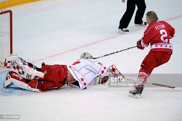Trevor Kidd of the Canada and Viacheslav Fetisov of the USSR during the friendly match between Canada Team and USSR Team during the 40th anniversary...