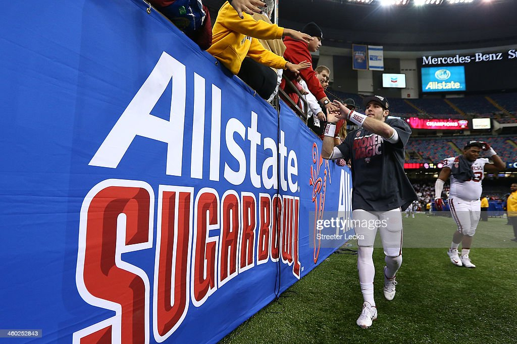 Trevor Knight of the Oklahoma Sooners celebrates with the MVP trophy after defeating the Alabama Crimson Tide 4531 during the Allstate Sugar Bowl at...