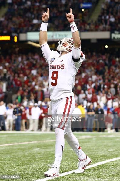 Trevor Knight of the Oklahoma Sooners reacts after throwing a touchdown pass against the Alabama Crimson Tide during the Allstate Sugar Bowl at the...