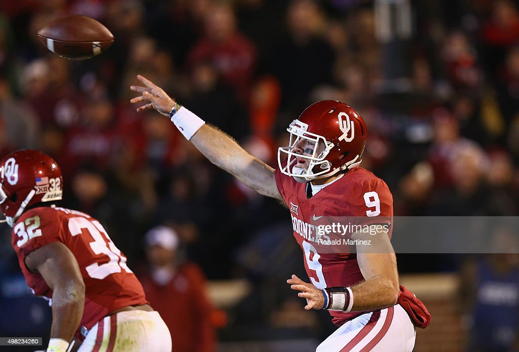 Trevor Knight #9 of the Oklahoma Sooners throws against the TCU Horned Frogs in the fourth quarter at Gaylord Family Oklahoma Memorial Stadium on November 21, 2015 in Norman, Oklahoma.