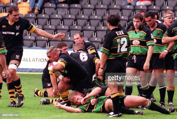 Trevor Leota of Wasps comes up holding the ball after scoring the sixth try against Northampton during the Zurich Premiership match at Loftus Road...