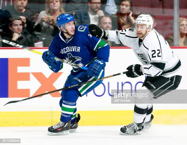 Trevor Lewis of the Los Angeles Kings and Alex Biega of the Vancouver Canucks skate up ice during their NHL game at Rogers Arena March 31 2017 in...