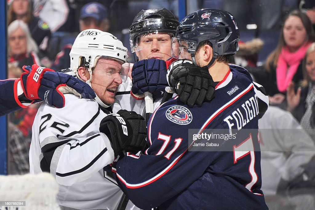 <a gi-track='captionPersonalityLinkClicked' href=/galleries/search?phrase=Trevor+Lewis&family=editorial&specificpeople=543187 ng-click='$event.stopPropagation()'>Trevor Lewis</a> #22 of the Los Angeles Kings and <a gi-track='captionPersonalityLinkClicked' href=/galleries/search?phrase=Nick+Foligno&family=editorial&specificpeople=537821 ng-click='$event.stopPropagation()'>Nick Foligno</a> #71 of the Columbus Blue Jackets scuffle behind the net in the second period on February 5, 2013 at Nationwide Arena in Columbus, Ohio. Los Angeles defeated Columbus 4-2.