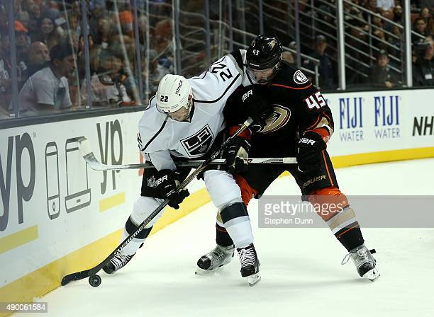 Trevor Lewis of the Los Angeles Kings and Sami Vatanen of the Anaheim Ducks fight for the puck during preseason at Honda Center on September 25 2015...