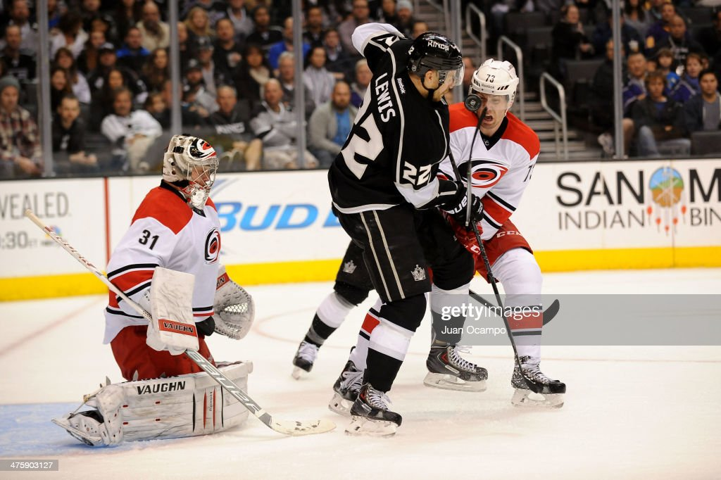 <a gi-track='captionPersonalityLinkClicked' href=/galleries/search?phrase=Trevor+Lewis&family=editorial&specificpeople=543187 ng-click='$event.stopPropagation()'>Trevor Lewis</a> #22 of the Los Angeles Kings battles for the puck against <a gi-track='captionPersonalityLinkClicked' href=/galleries/search?phrase=Brett+Bellemore&family=editorial&specificpeople=4270909 ng-click='$event.stopPropagation()'>Brett Bellemore</a> #73 of the Carolina Hurricanes at Staples Center on March 1, 2014 in Los Angeles, California.