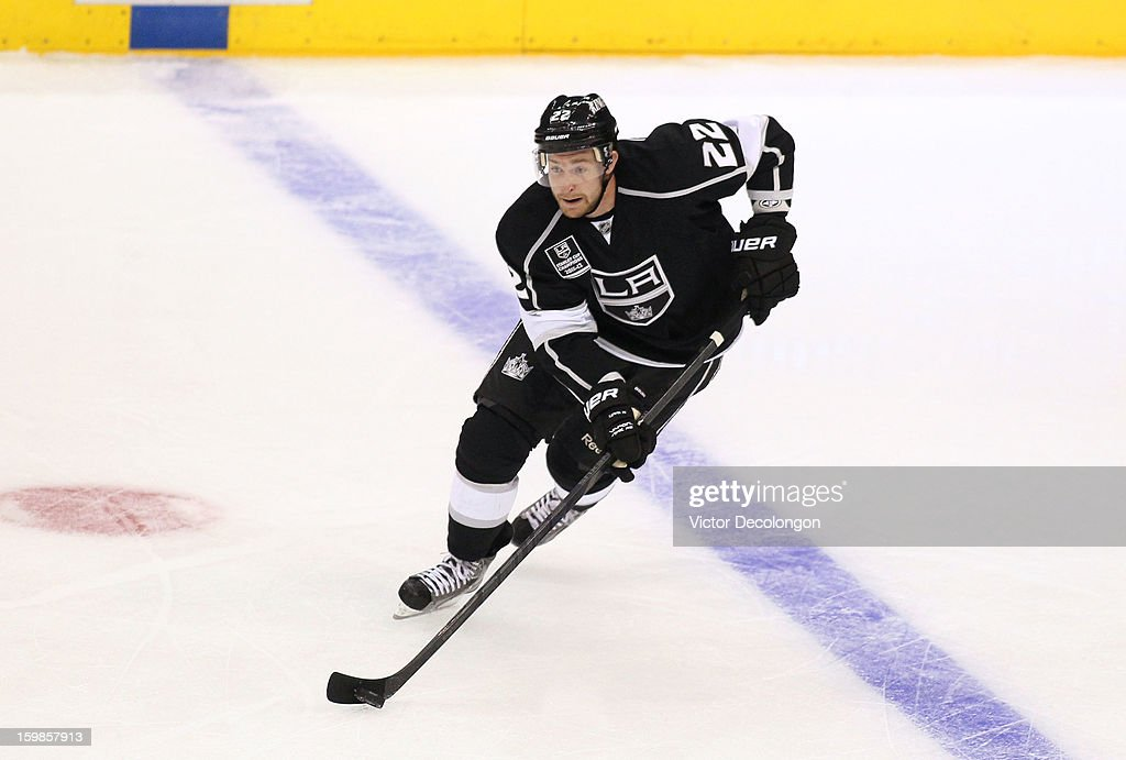 <a gi-track='captionPersonalityLinkClicked' href=/galleries/search?phrase=Trevor+Lewis&family=editorial&specificpeople=543187 ng-click='$event.stopPropagation()'>Trevor Lewis</a> #22 of the Los Angeles Kings carries the puck through the netural zone during the NHL game against the Chicago Blackhawks at Staples Center on January 19, 2013 in Los Angeles, California. The Blackhawks defeated the Kings 5-2.