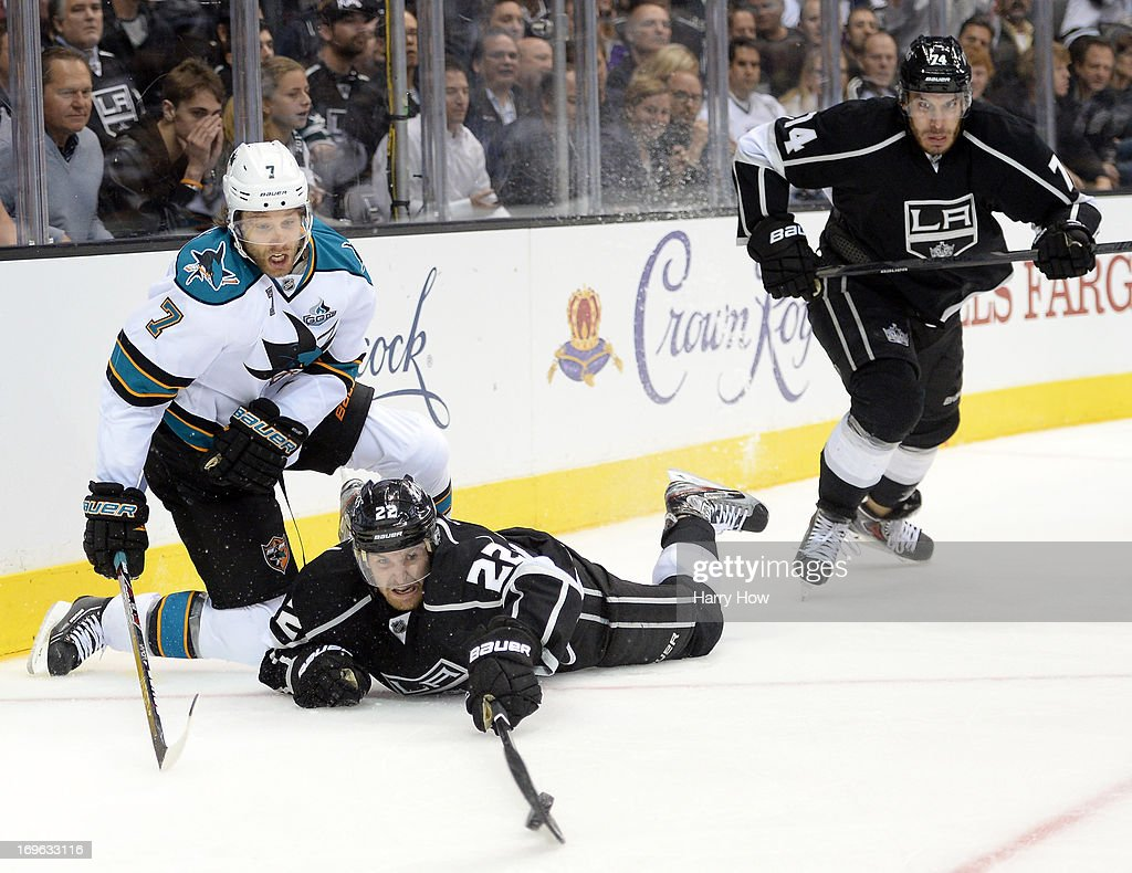 <a gi-track='captionPersonalityLinkClicked' href=/galleries/search?phrase=Trevor+Lewis&family=editorial&specificpeople=543187 ng-click='$event.stopPropagation()'>Trevor Lewis</a> #22 of the Los Angeles Kings dives for the puck with <a gi-track='captionPersonalityLinkClicked' href=/galleries/search?phrase=Brad+Stuart+-+Ice+Hockey+Player&family=editorial&specificpeople=213995 ng-click='$event.stopPropagation()'>Brad Stuart</a> #7 of the San Jose Sharks as <a gi-track='captionPersonalityLinkClicked' href=/galleries/search?phrase=Dwight+King+-+Ice+Hockey+Player&family=editorial&specificpeople=4537297 ng-click='$event.stopPropagation()'>Dwight King</a> #74 givs cahse during the second period in Game Five of the Western Conference Semifinals during the 2013 Stanley Cup Playoffs at Staples Center on May 23, 2013 in Los Angeles, California.
