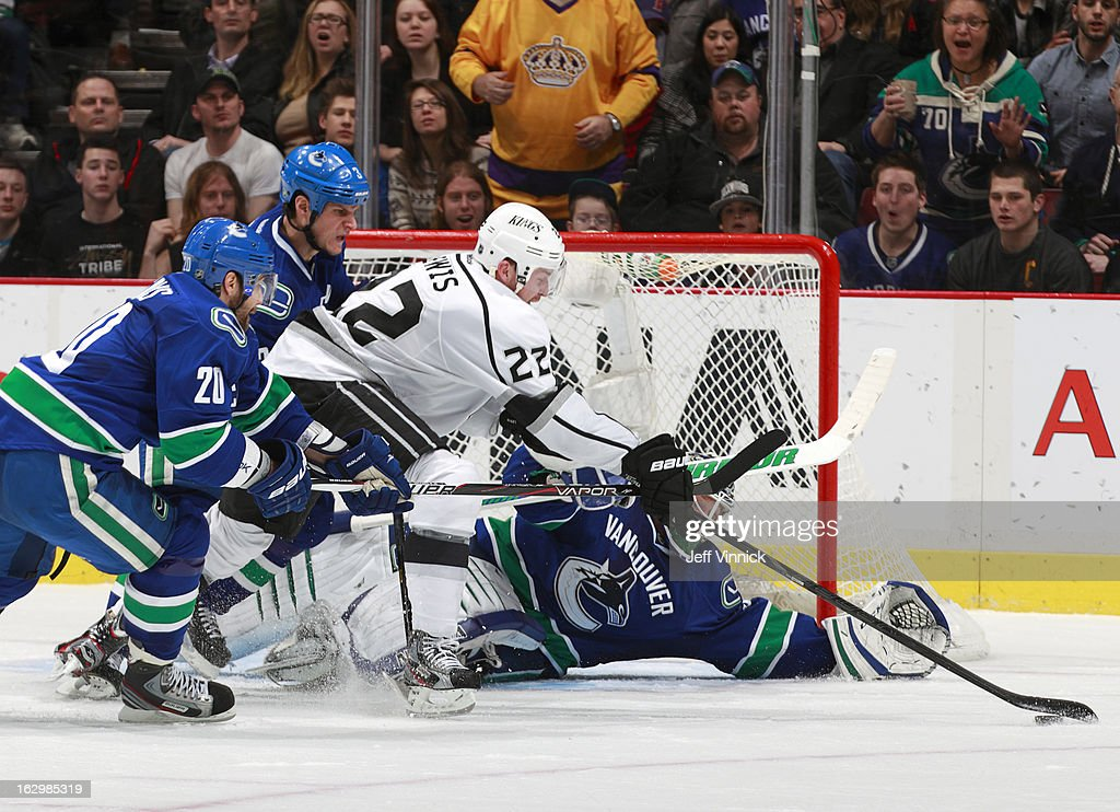 <a gi-track='captionPersonalityLinkClicked' href=/galleries/search?phrase=Trevor+Lewis&family=editorial&specificpeople=543187 ng-click='$event.stopPropagation()'>Trevor Lewis</a> #22 of the Los Angeles Kings reaches for the puck between <a gi-track='captionPersonalityLinkClicked' href=/galleries/search?phrase=Kevin+Bieksa&family=editorial&specificpeople=688792 ng-click='$event.stopPropagation()'>Kevin Bieksa</a> #3, Chris Higgins #20 and <a gi-track='captionPersonalityLinkClicked' href=/galleries/search?phrase=Cory+Schneider&family=editorial&specificpeople=696908 ng-click='$event.stopPropagation()'>Cory Schneider</a> #35 of the Vancouver Canucks during their NHL game at Rogers Arena March 2, 2013 in Vancouver, British Columbia, Canada.