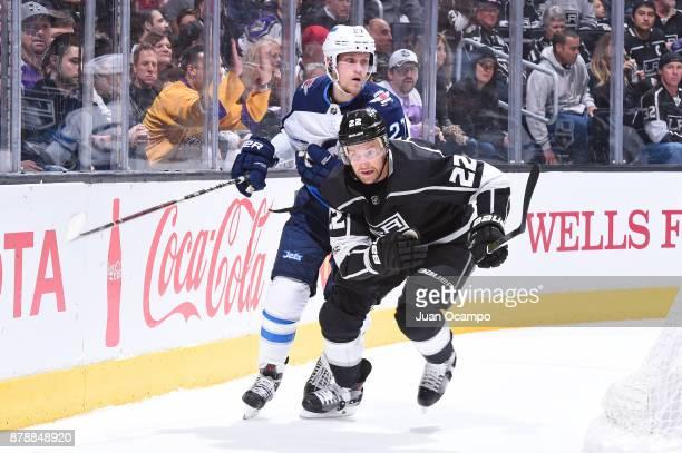 Trevor Lewis of the Los Angeles Kings skates against Nikolaj Ehlers of the Winnipeg Jets at STAPLES Center on November 22 2017 in Los Angeles...