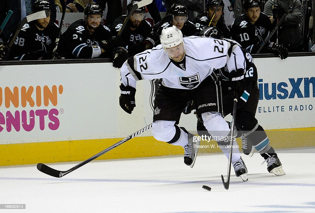 Trevor Lewis #22 of the Los Angeles Kings skates with control of the puck ahead of Patrick Marleau #12 of the San Jose Sharks in the third period in Game Three of the Western Conference Semifinals during the 2013 NHL Stanley Cup Playoffs at HP Pavilion on May 18, 2013 in San Jose, California. The Sharks won the game in overtime 2-1.