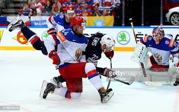 Trevor Lewis of USA and Yegor Yakovlev of Russia battle for the puck during the IIHF World Championship semi final match between USA and Russia at O2...