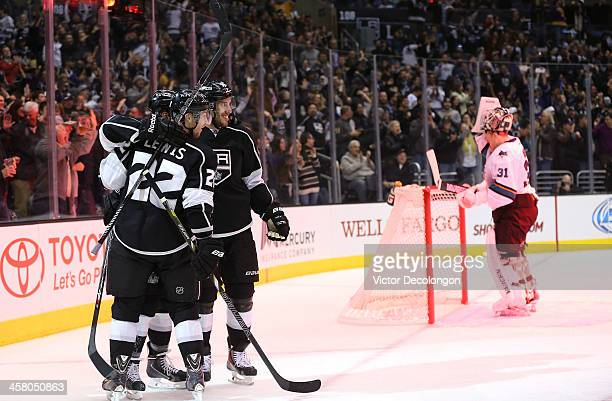 Trevor Lewis Tyler Toffoli and Dwight King of the Los Angeles Kings celebrate Toffoli's second period goal as goaltender Antti Niemi of the San Jose...