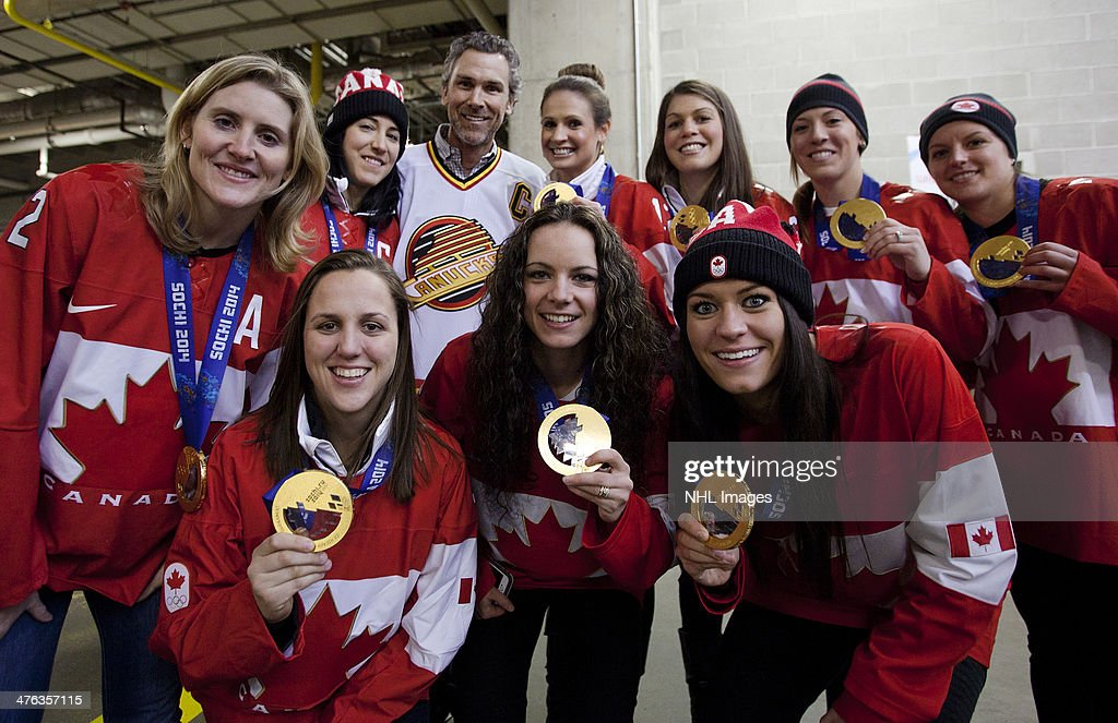 Trevor Linden, captain of the 1994 Vancouver Canucks poses with members of the 2014 Canadian Olympic Women's gold medal hockey team prior to the 2014 Tim Hortons Heritage Classic between the Ottawa Senators and the Vancouver Canucks at BC Place on March 2, 2014 in Vancouver, B.C., Canada.
