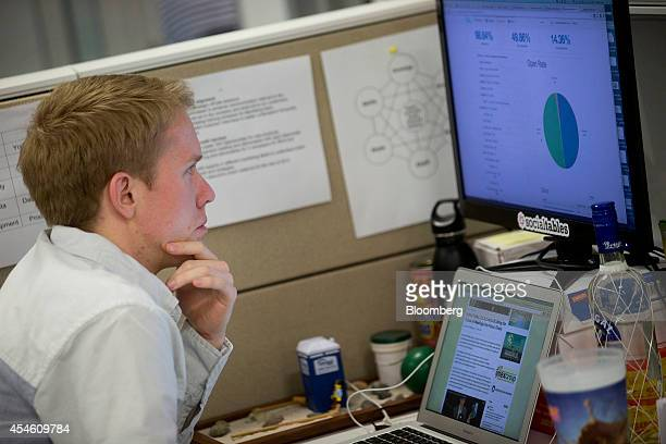 Trevor Lynn chief marketing officer at Social Tables Inc works at his desk at the company's headquarters in Washington DC US on Thursday Aug 14 2014...