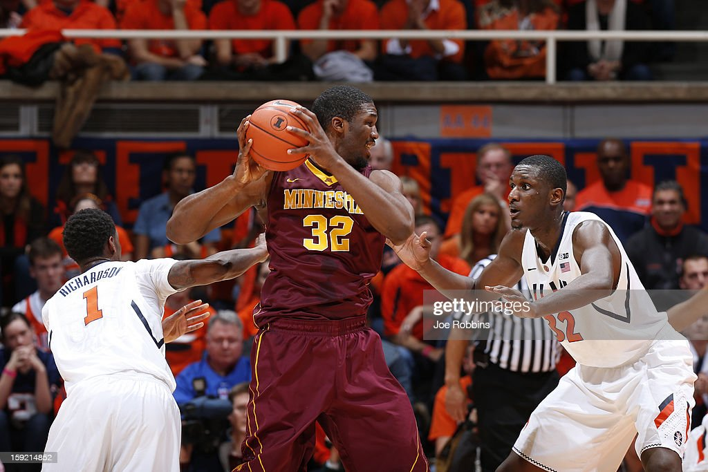 Trevor Mbakwe #32 of the Minnesota Golden Gophers tries to keep the ball away from Nnanna Egwu #32 of the Illinois Fighting Illini during the game at Assembly Hall on January 9, 2013 in Champaign, Illinois.