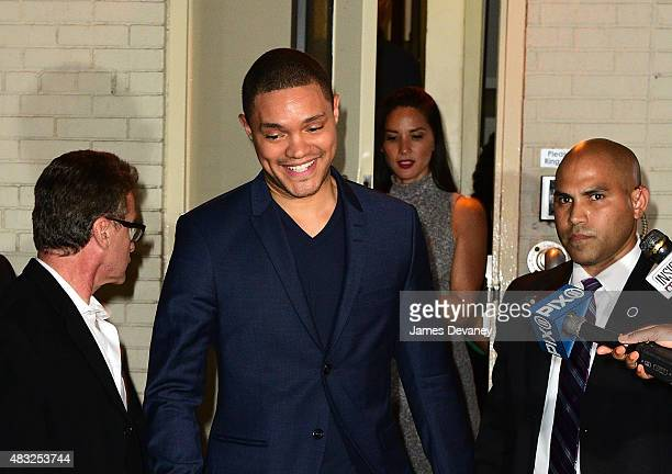 Trevor Noah and Olivia Munn leave 'The Daily Show With Jon Stewart' at the Daily Show Building on August 6 2015 in New York City