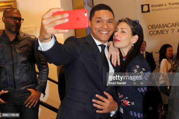 Trevor Noah and Stacy London attends the Donald J Trump Presidential Twitter Library Opening Reception presented by Comedy Central's The Daily Show...