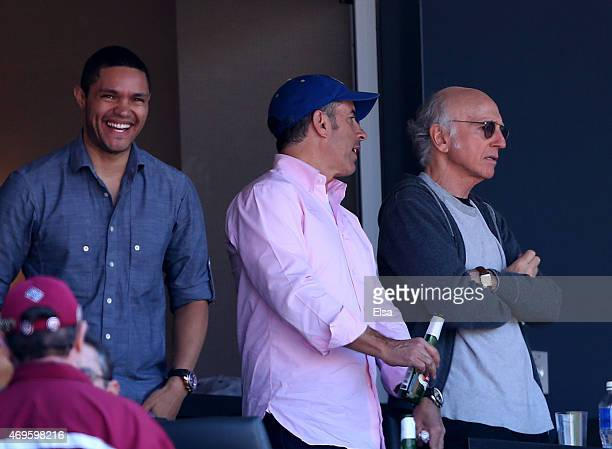 Trevor Noah Jerry Seinfeld and Larry David watch the game between the New York Mets and the Philadelphia Phillies during Opening Day on April 13 2015...