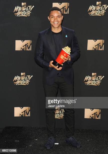 Trevor Noah poses in the press room at the 2017 MTV Movie and TV Awards at The Shrine Auditorium on May 7 2017 in Los Angeles California