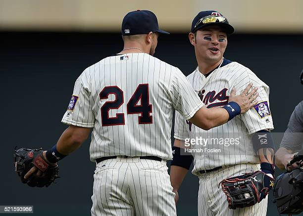 Trevor Plouffe and Byung Ho Park of the Minnesota Twins celebrate a win of the game against the Los Angeles Angels of Anaheim on April 16 2016 at...
