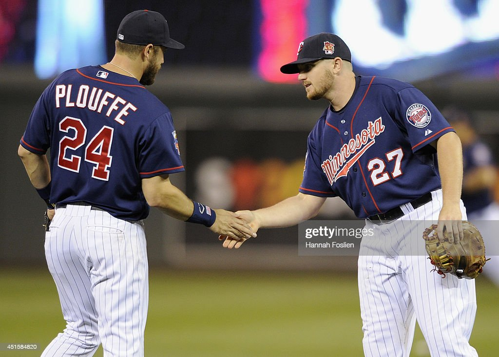 Trevor Plouffe #24 and Chris Parmelee #27 of the Minnesota Twins celebrates a win of the game against the Kansas City Royals on July 1, 2014 at Target Field in Minneapolis, Minnesota. The Twins defeated the Royals 10-2.