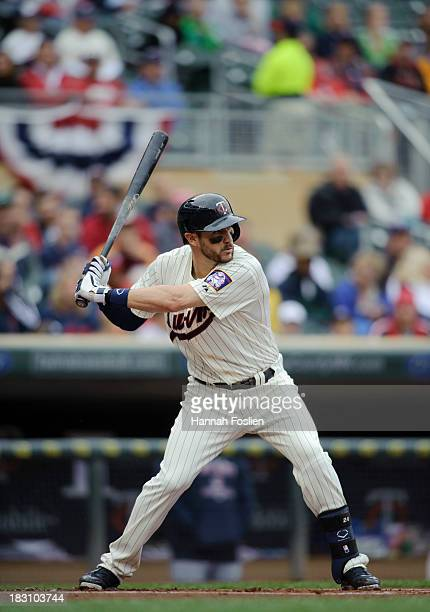 Trevor Plouffe of the Minnesota Twins bats against the Cleveland Indians during the game on September 28 2013 at Target Field in Minneapolis Minnesota