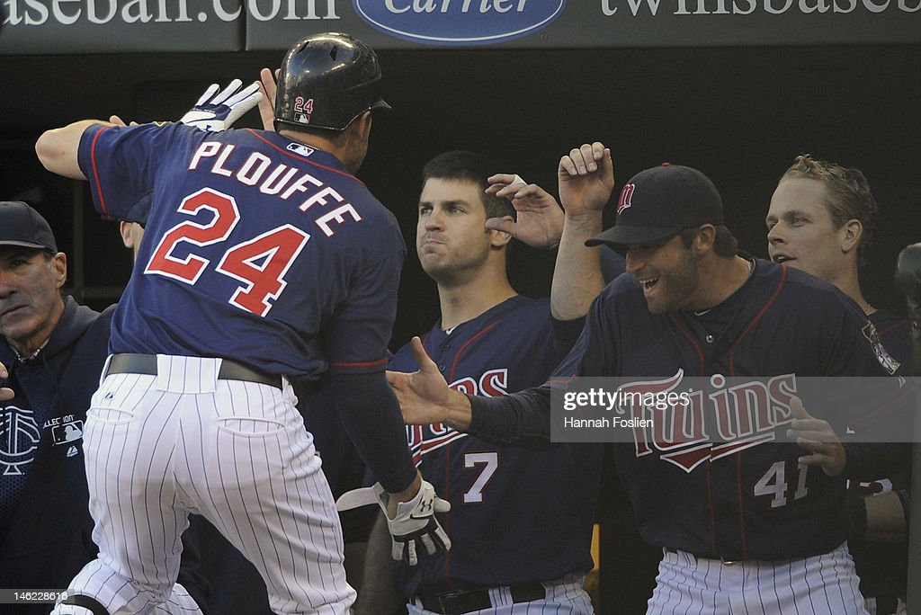<a gi-track='captionPersonalityLinkClicked' href=/galleries/search?phrase=Trevor+Plouffe&family=editorial&specificpeople=5722348 ng-click='$event.stopPropagation()'>Trevor Plouffe</a> #24 of the Minnesota Twins celebrates a two-run home run against the Philadelphia Phillies during the second inning with <a gi-track='captionPersonalityLinkClicked' href=/galleries/search?phrase=Joe+Mauer&family=editorial&specificpeople=214614 ng-click='$event.stopPropagation()'>Joe Mauer</a> #7 and <a gi-track='captionPersonalityLinkClicked' href=/galleries/search?phrase=Drew+Butera&family=editorial&specificpeople=4175498 ng-click='$event.stopPropagation()'>Drew Butera</a> #41 on June 12, 2012 at Target Field in Minneapolis, Minnesota.