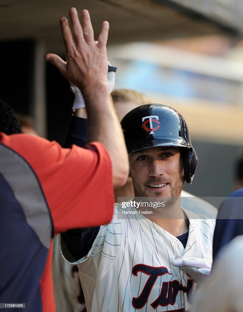 <a gi-track='captionPersonalityLinkClicked' href=/galleries/search?phrase=Trevor+Plouffe&family=editorial&specificpeople=5722348 ng-click='$event.stopPropagation()'>Trevor Plouffe</a> #24 of the Minnesota Twins celebrates hitting a solo home run against the New York Yankees during the fifth inning of the game on July 3, 2013 at Target Field in Minneapolis, Minnesota.