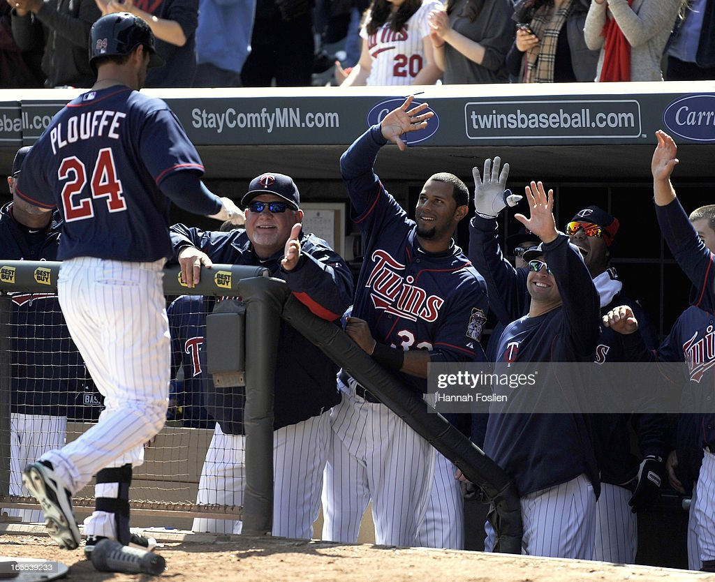 <a gi-track='captionPersonalityLinkClicked' href=/galleries/search?phrase=Trevor+Plouffe&family=editorial&specificpeople=5722348 ng-click='$event.stopPropagation()'>Trevor Plouffe</a> #24 of the Minnesota Twins celebrates with his teammates after hitting a solo home run against the Detroit Tigers during the fourth inning of the game on April 4, 2013 at Target Field in Minneapolis, Minnesota.