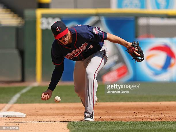 Trevor Plouffe of the Minnesota Twins drops a ball hit by Tyler Flowers of the Chicago White Sox at US Cellular Field on April 21 2013 in Chicago...