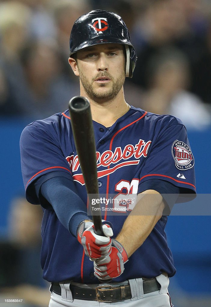 Trevor Plouffe #24 of the Minnesota Twins during his at bat during MLB game action against the Toronto Blue Jays on October 3, 2012 at Rogers Centre in Toronto, Ontario, Canada.