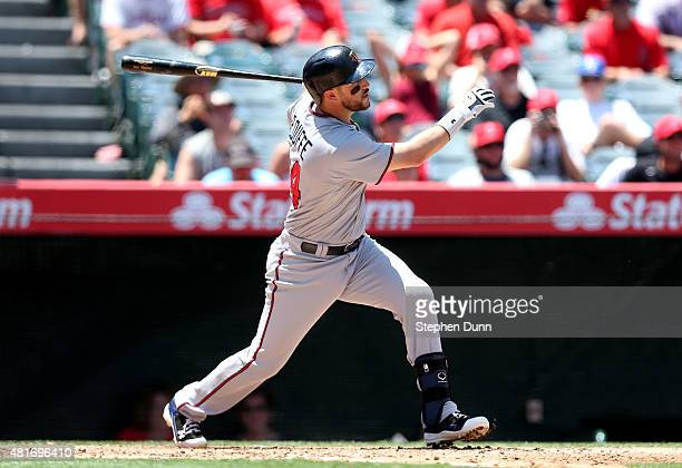 Trevor Plouffe of the Minnesota Twins hits a three run home run in thefourth inning against the Los Angeles Angels of Anaheim at Angel Stadium of...