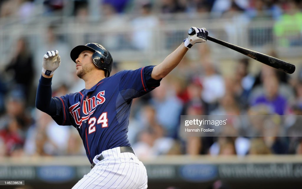 <a gi-track='captionPersonalityLinkClicked' href=/galleries/search?phrase=Trevor+Plouffe&family=editorial&specificpeople=5722348 ng-click='$event.stopPropagation()'>Trevor Plouffe</a> #24 of the Minnesota Twins hits a two-run home run against the Philadelphia Phillies during the second inning on June 12, 2012 at Target Field in Minneapolis, Minnesota.