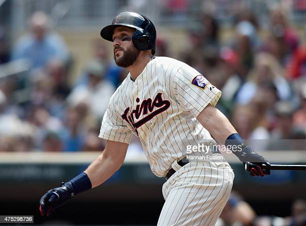 Trevor Plouffe of the Minnesota Twins hits an RBI double against the Toronto Blue Jays during the fourth inning of the game on May 30 2015 at Target...