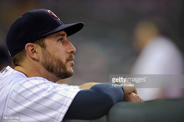 Trevor Plouffe of the Minnesota Twins looks on before the game against the Cleveland Indians on September 27 2013 at Target Field in Minneapolis...